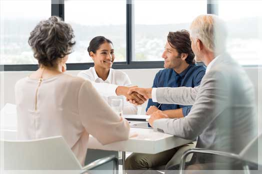 mature couple consulting with insurance agent